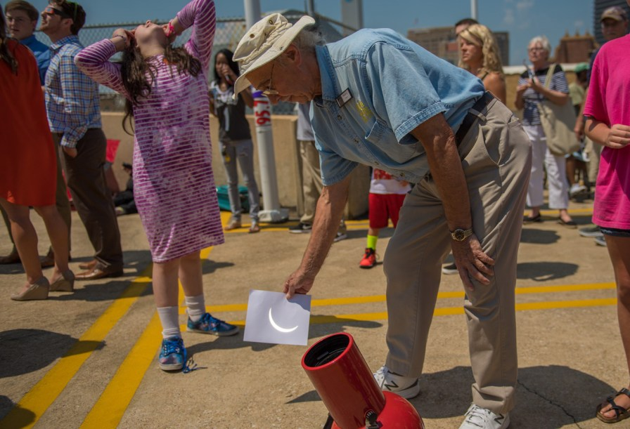 Volunteer Hugh Sager, teacher of 20 years to gifted kids in Jefferson County, projects the solar eclipse from a telescope at McWane Science Center. (Phil Free / Alabama NewsCenter)