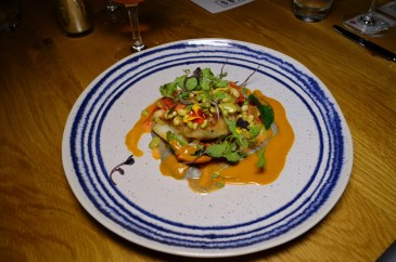 Feros' seared cod (with curry leaves, butter beans and eggplant). (Michael Tomberlin / Alabama NewsCenter)