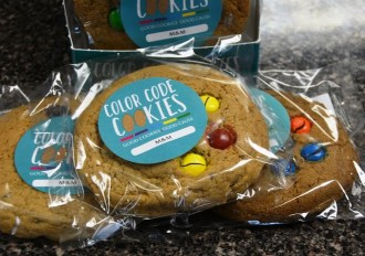 """Each package of Color Code Cookies sums it up this way: """"Good cookies. Good cause."""" (Karim Shamsi-Basha/Alabama NewsCenter)"""