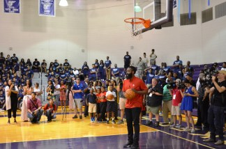 Houston Rockets guard James Harden hangs out with students at the gym in Parker High School. (Michael Tomberlin / Alabama NewsCenter)