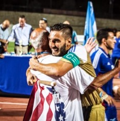 A player hugs coach Preston Goldfarb after the USA team won the 2017 World Maccabiah Games soccer championship. (Contributed)