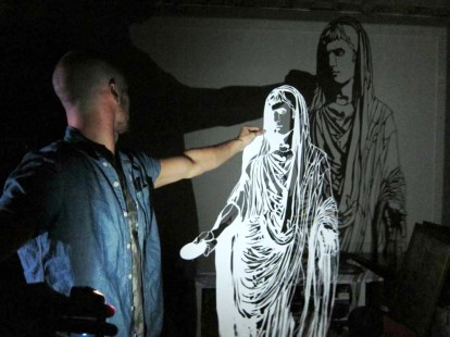 Artist RC Hagans with one of his cutouts. (Anne Kristoff/Alabama NewsCenter)