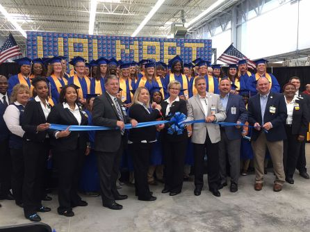 Training Academy graduates join Walmart leadership in cutting the ribbon for the academy's official opening. (Keisa Sharpe/Alabama NewsCenter)