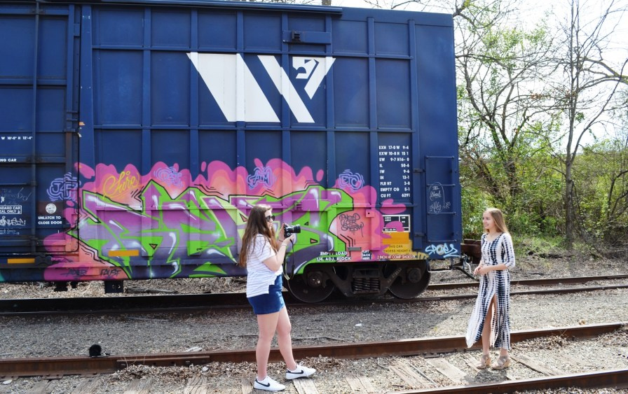 Young Opelikans conduct a photo shoot on the tracks that anchor downtown. (Anne Kristoff/Alabama NewsCenter)