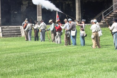 Infantrymen fire their muskets during the living history event at Fort Morgan commemorating the Battle of Mobile Bay. (Robert DeWitt / Alabama NewsCenter)