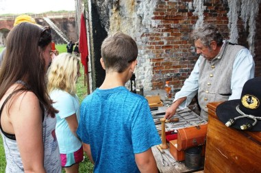 Bert Blackburn talks to visitors about Civil War-era medical practices during the living history event at Fort Morgan commemorating the Battle of Mobile Bay. (Robert DeWitt / Alabama NewsCenter)