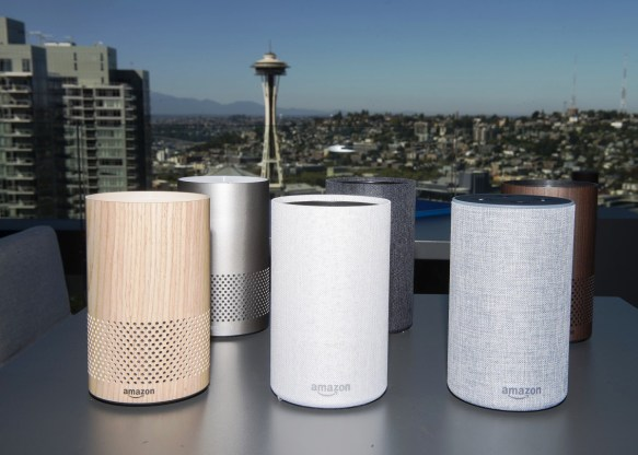 The new Amazon.com Inc. Echo devices sit on display in front of the Seattle Space Needle during the company's product reveal launch event in downtown Seattle. Amazon unveiled a smaller, cheaper version of its popular Alexa-powered Echo speaker that the e-commerce giant said has better sound. (Daniel Berman/Bloomberg)