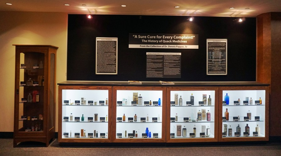 Every bottle in the McWane Science Center exhibit tells a story of medical quackery. (Erin Harney/Alabama NewsCenter)