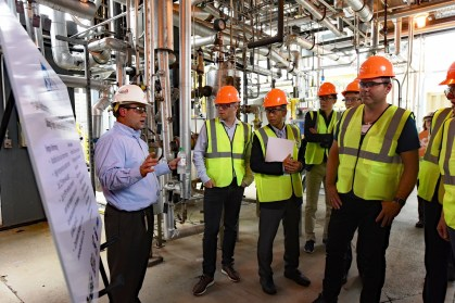 Senior engineer John Carroll, left, describes a project underway with technology partner Southern Research of Birmingham. (Wynter Byrd / Alabama NewsCenter)