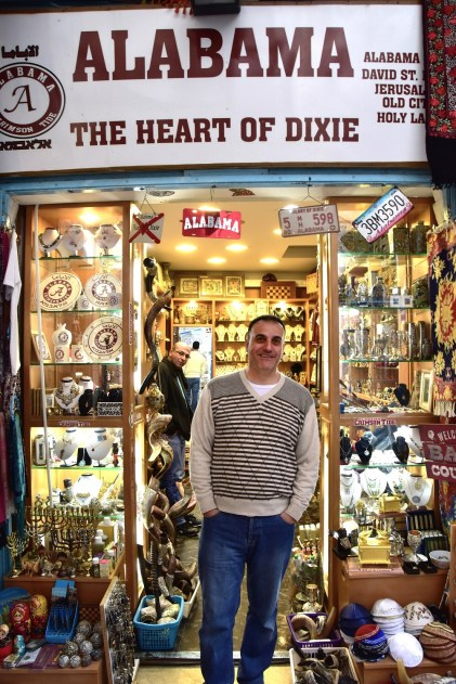 "Hani Imam will deliver a hearty ""Roll Tide!"" to visitors of his University of Alabama-themed shop in Jerusalem. (Karim Shamsi-Basha / Alabama NewsCenter)"