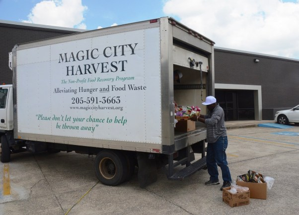 A worker loads a truck with healthy food to be distributed. (Karim Shamsi-Basha/Alabama NewsCenter)