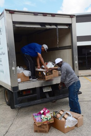 Workers load a truck with healthy food to be distributed. (Karim Shamsi-Basha/Alabama NewsCenter)