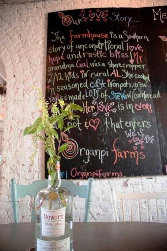 A blackboard tells the story behind Organpi Farms Farmhouse. (Brittany Faush/Alabama NewsCenter)