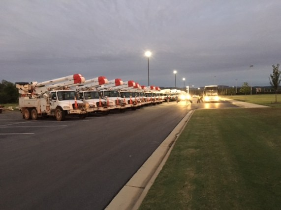 Power trucks ready to roll out Wednesday to continue the job of restoring power lost this week during Tropical Storm Irma. (Contributed)