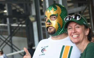 "Rich Mansfield portrays ""Bernie Masked Man"" on his monthly comedy talk show. He opted for the green and gold dragon style to be part of the atmosphere at UAB games. His wife Sara works in research in the UAB School of Health Professions. (Solomon Crenshaw Jr. / Alabama NewsCenter)"