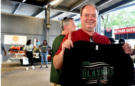 Sonny Best of LaPine, Ala., shows the T-shirt he bought after attending his first UAB football game. (Solomon Crenshaw Jr. / Alabama NewsCenter)