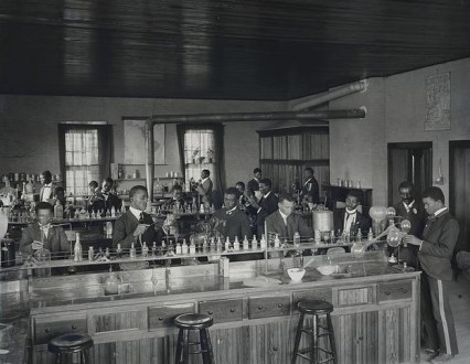Chemistry laboratory at Tuskegee Institute, c. 1902. George Washington Carver stands second from right, facing front. (Photograph by Frances Benjamin Johnston, Library of Congress Prints and Photographs Division)