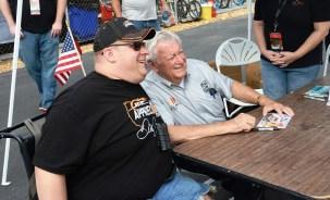 Racing legend Bobby Allison poses with a fan. (Karim Shamsi-Basha / Alabama NewsCenter)