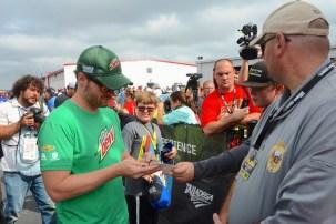 Dale Earnhardt Jr. Signs autographs. (Karim Shamsi-Basha / Alabama NewsCenter)