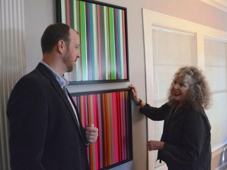 Alex and Eileen Kunzman discuss two Jon Coffelt pieces titled Duct Tape. (Karim Shamsi-Basha / Alabama NewsCenter)