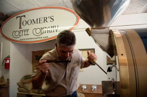 Sandy Toomer uses his nose to check a batch of Toomer's Coffee. The company sells more than 20 blends. (Brittany Faush / Alabama NewsCenter)