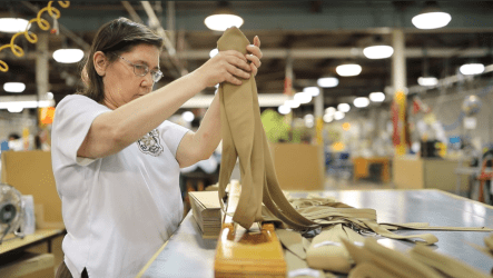 Workers at Alabama Industries for the Blind supply ties for all branches of the U.S. military. (Joseph Allen / Alabama NewsCenter)
