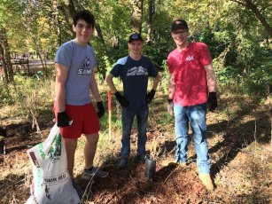 Samford students volunteer at the Shades Creek Greenway tree planting. From left, Reese Cameron, Josh Hunt and Nate Van Dyke.​ (Jesse Chambers / Homewood Star)