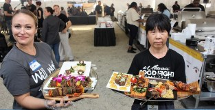 Competitors present their dishes to the judges at the World Food Championships in Orange Beach. (Robert DeWitt / Alabama NewsCenter)