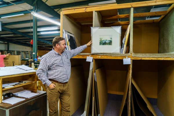 Tim Davis and his wife, Mary, went from employees to owners at Shadow Catchers when the previous owner retired. (Mark Sandlin / Alabama NewsCenter)
