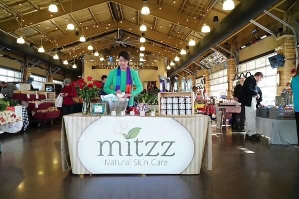 Tonya Moran offers her wares for sale at Tuscaloosa River Market. (Mark Sandlin / Alabama NewsCenter)