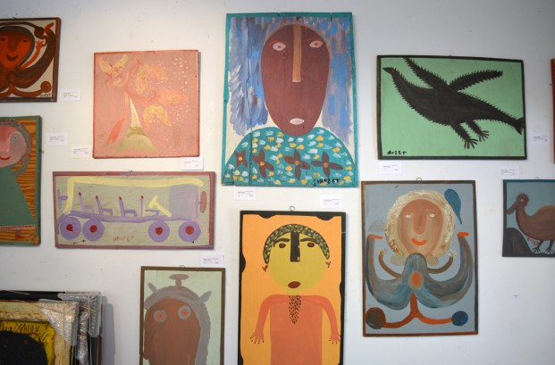 A wall of Mose Tolliver paintings. (Anne Kristoff / Alabama NewsCenter)