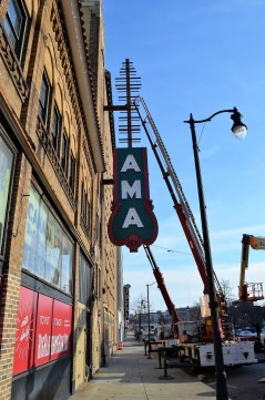 Workers this week install the Alabama Theatre's new side sign on 18th Street. The sign will be turned on at midnight New Year's Eve. (Michael Tomberlin / Alabama NewsCenter)