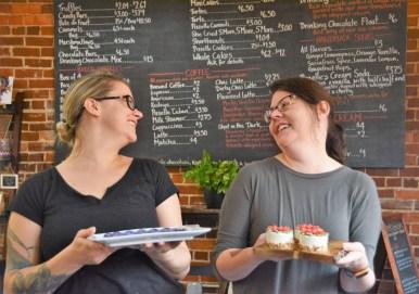 Sisters Michelle Novosel, left, and Caitlin Lyon hold some of their creations in the dessert café. (Karim Shamsi-Basha / Alabama NewsCenter)