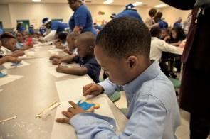 South Hampton children enjoy some Christmas fun courtesy of Project Blue Elf. (Brittany Faush / Alabama NewsCenter)