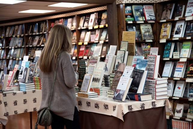 A shopper peruses some of the signed titles available at The Alabama Booksmith. (Brittany Faush / Alabama NewsCenter)