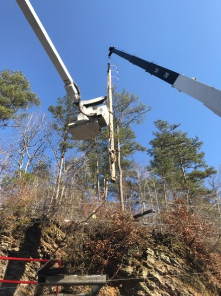 An Alabama Power crew led by Pat Samya and Jay Porter works to restore electric service near Hollis Crossroads and DeArmanville along U.S. Highway 431. (Alabama Power)