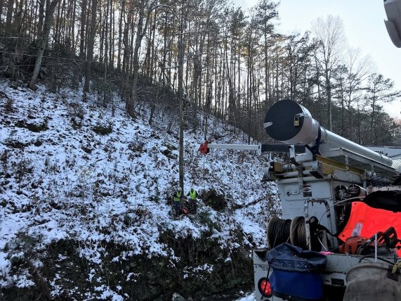 An Alabama Power crew works to restore electric service following Friday's surprisingly heavy snowfall. (Alabama Power)