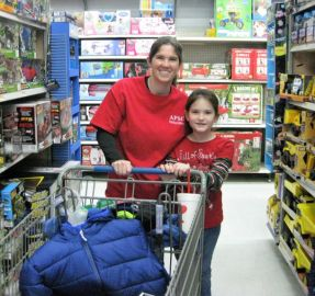 APSO volunteer Megan Handley (left) and daughter Cala shopped for toys. (Terri Black)