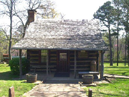 Reproduction of Sequoyah's log cabin, now a Native American museum in Sequoyah County, Oklahoma. The original, located inside an adjacent protective building, is on the National Register of Historic Places. (Tonya Stinson, Wikipedia)