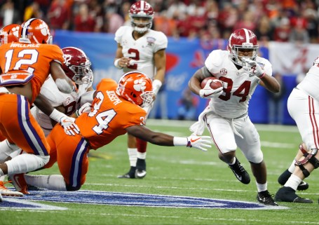 Alabama running back Damien Harris (34) gains some yards against Clemson. (Crimson Tide Photos)