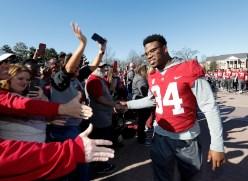 Alabama running back Damien Harris (34) celebrates with fans. (Amelia B. Barton)