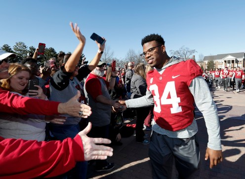 Alabama running back Damien Harris (34) celebrates with fans. (Amelia B. Barton)