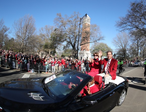 Nick and Terry Saban ride in the national championship celebration parade. (Kent Gidley)