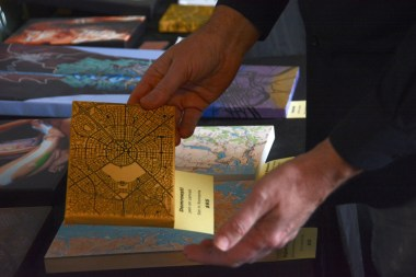 David Nuttall holds one of his Artimaps. (Karim Shamsi-Basha / Alabama NewsCenter)
