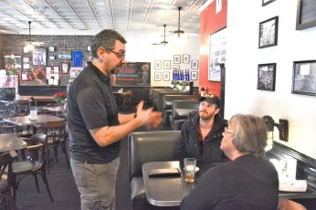 Marco Morosini chats with customers at Silvertron. (Karim Shamsi-Basha / Alabama NewsCenter)