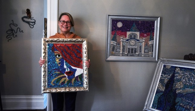 Kathleen McCarron found her unusual medium, Mardi Gras beads, about nine years ago after years painting with more conventional materials. (Karim Shamsi-Basha / Alabama NewsCenter)