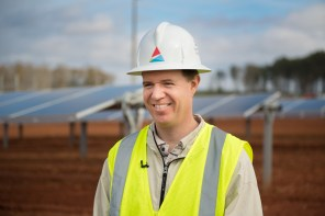 Alabama Power's Chris Habig joins some of the company's partners for a look at the new 338,662-panel solar power facility near LaFayette. (Phil Free / Alabama NewsCenter)