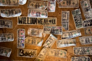 Customers leave their mark at Nick's and enjoy looking for their old dollars when they come back. (Brittany Faush / Alabama NewsCenter)