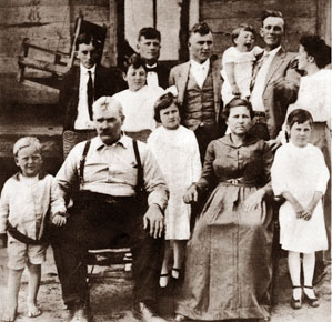 """Paul """"Bear"""" Bryant, front left, was born in rural Arkansas in 1913, the 11th of 12 siblings. As a youth, he worked on the family farm and played sports at Fordyce High School. (From Encyclopedia of Alabama, courtesy of Paul W. Bryant Museum, University of Alabama)"""