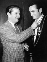 Music producer Sam Phillips, left, is seen with singer-songwriter Johnny Cash. The two collaborated during the 1950s, early in Cash's career. (From Encyclopedia of Alabama, courtesy of the Alabama Music Hall of Fame)